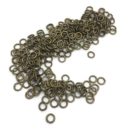 "1/4  dry ounce antique bronze  finish open  jump rings 1 mm thick by 6 mm round or 1/4 "" round by 2/16 thick"
