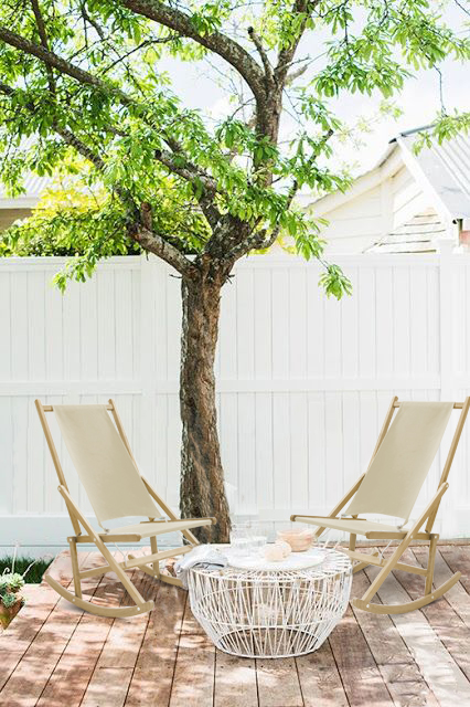 Beach rocking deck chairs under tree