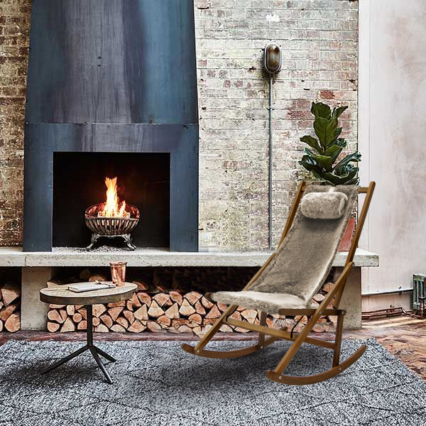 Rocking chair by the fire place