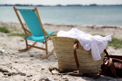 Folding deck chair at the beach