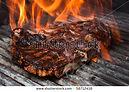 stock-photo-t-bone-steak-on-barbecue-gri