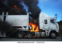 stock-photo-car-carrier-on-fire-and-burn