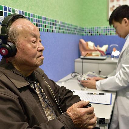 elderly on hearing test.jpg
