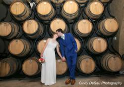 bride and groom in barrel room