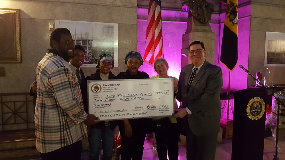 "Getting an award ""check"" from the Mayor"