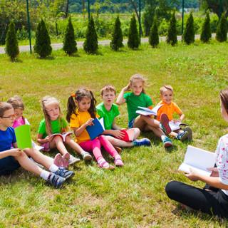 Acquaintance of the teacher and children outdoors.jpg