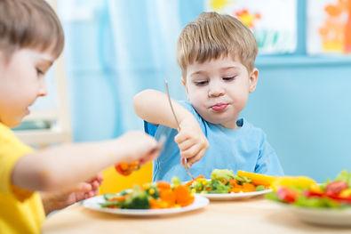 kids children eating vegetables in kinde
