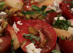 Peach and Tomato Salad with Salted Pistachios Feta & Basil Chiffonade