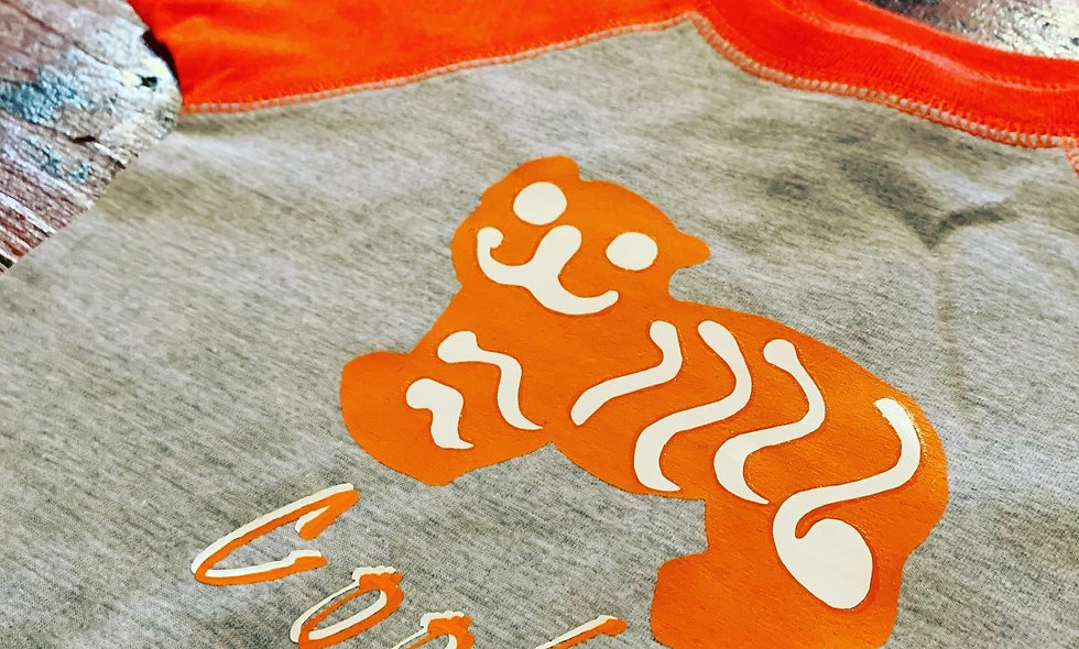 Tiger Cookie Onesie with Orange capped sleeves and trim