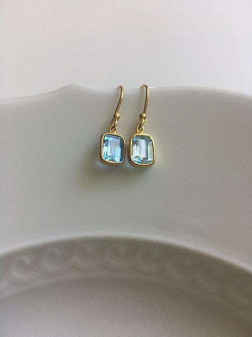 Blue Topaz Earrings in 14 kt Gold Bezel