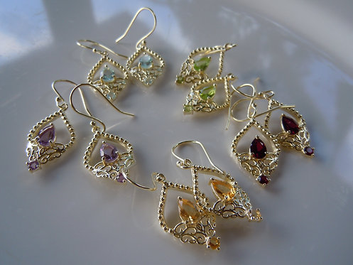 Faceted GemstoneTeardrops in Elaborate Gold Setting