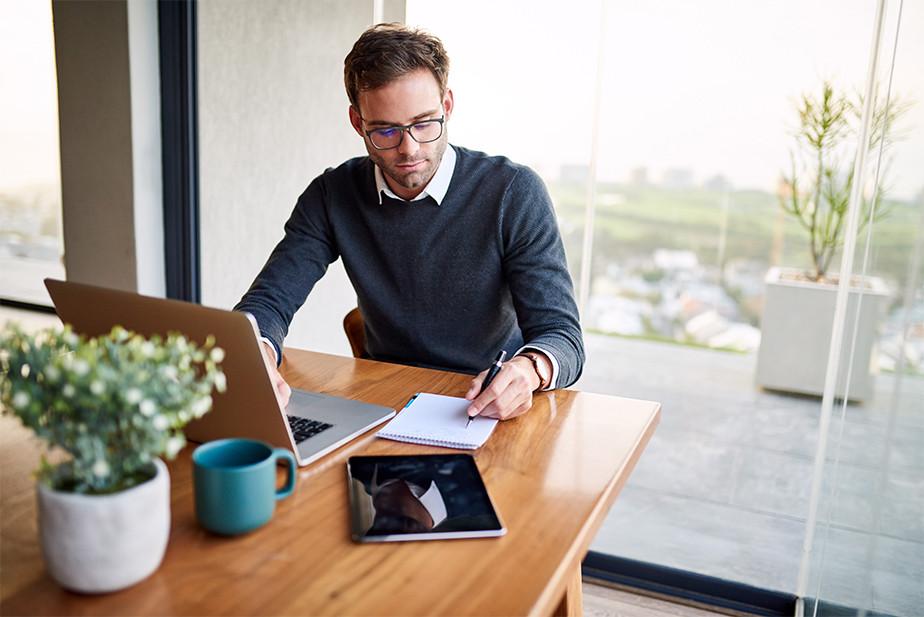 A man writing a business proposal