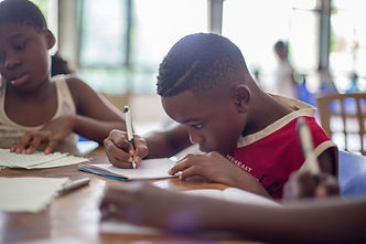 Young boy writing.jpg