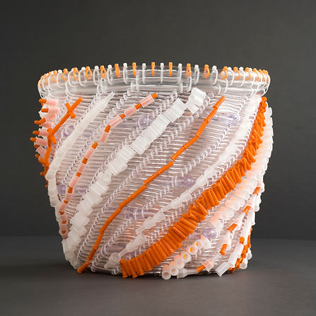 An innovative vessel by basket artist Emily Dvorin, made frrom oxygen tubing, syringe caps, beads, monofilament,  & cable ties.