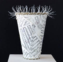 Contemporary basketry artist Emily Dvorin created an innovative vessels featuring sheet music and cable ties.
