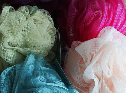 Bath poofs to be used to create a contemporary vessel by Sausalito basket artist, Emily Dvorin.