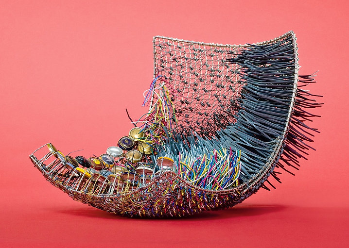 A contemporary vessel created by Sausalito basketry artist, Emily Dvorin, from metal mesh, champagne cork cages, bobby pins, electrical wire, & cable ties.