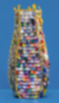 A vessel created by baske artist Emily Dvorin made from gutter screening, travel pins, Cracker Jack prizes, guitar picks crafted from credit, debit, gift and ID cards, cocktail umbrellas, measuring tape, telephone wire, & cable ties.