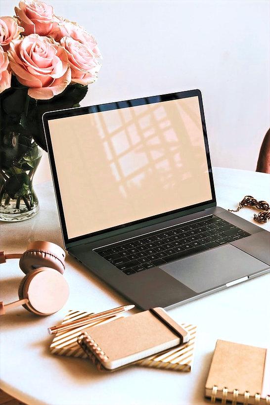laptop, flower and headphones