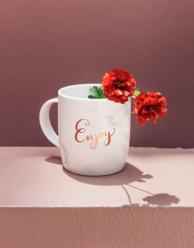 enjoy written on cup