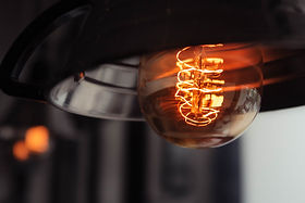 closeup-shot-lit-large-lightbulb-with-bl