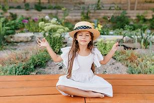 pretty-brunette-female-kid-straw-hat-sit