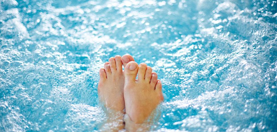 Close-up of female legs in hot tub.jpg
