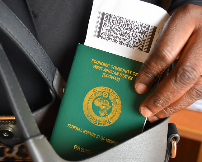 Nigerian passport and flight ticket in woman's bag