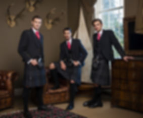 Three men in full kilt outifts
