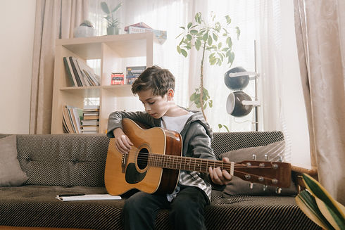 man-in-gray-long-sleeve-shirt-playing-br
