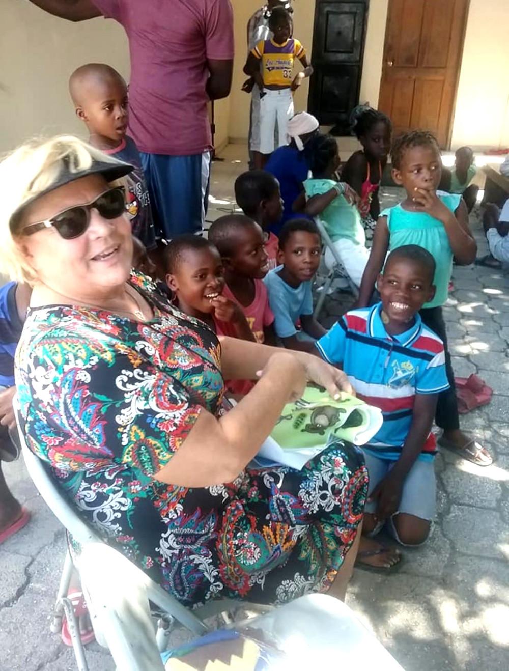 Becky enjoying teaching the Haitian Children and they in turn enjoying being fed.