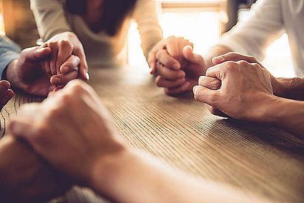 Prayer Group holding hands.