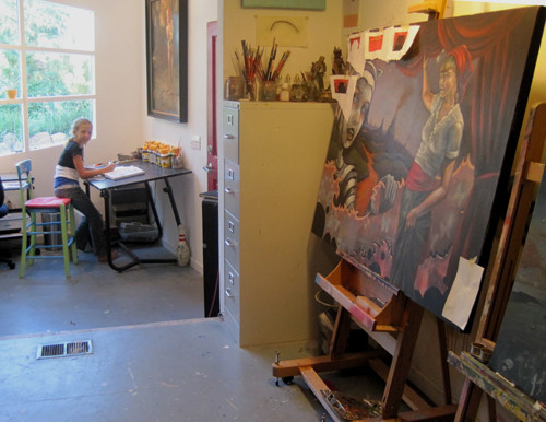 Zoe working at the drawing table