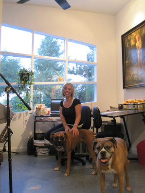 """Michelle working on the website in the studio """"office"""" with Cedar and Daisy"""