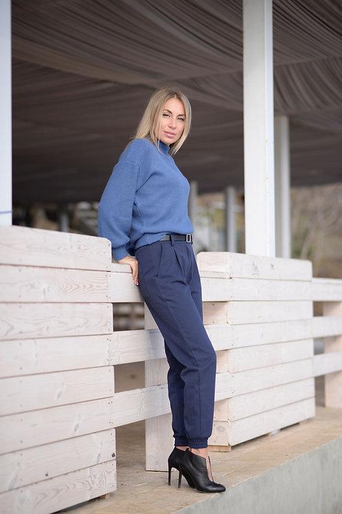 Синие брюки с карманами