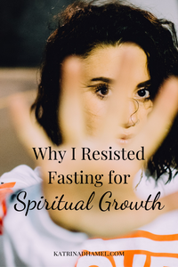 Woman holding hand out in front of her and the text 'Why I resisted Fasting for Spiritual Growth'