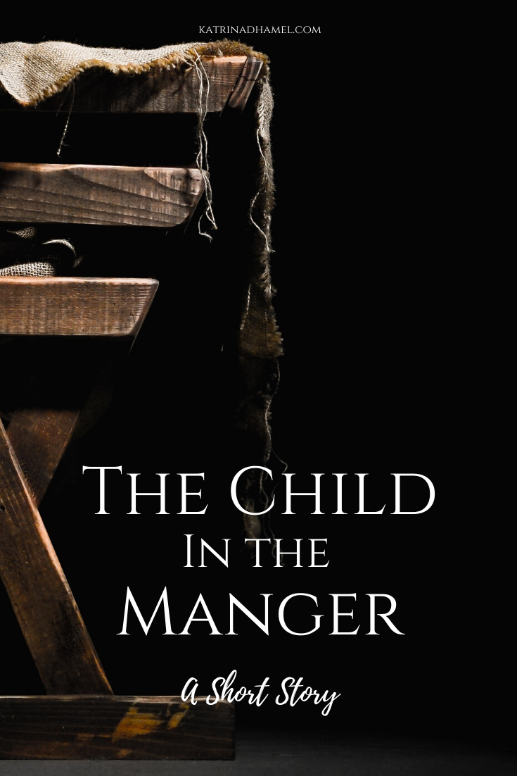 A rustic manger with rough cloth and the words 'The Child in the Manger a short story'