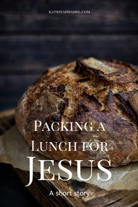 A round crusty loaf of bread in a rustic setting with the text 'Packing a Lunch for Jesus, a short story'.