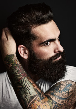 Longer men's cut with full beard