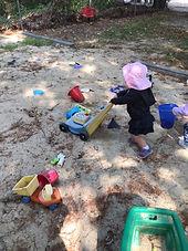 toddlerPlayinSandbox.jpg