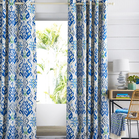 Bright printed curtain on a window