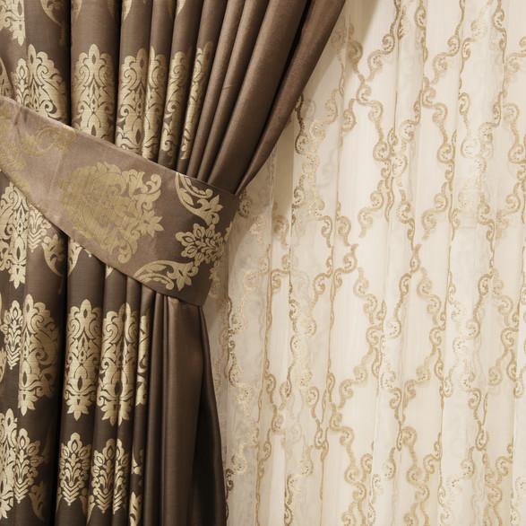 Part of beautifully draped curtain