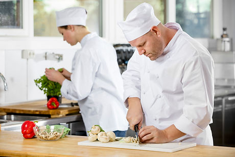graphicstock-two-professional-chefs-prep