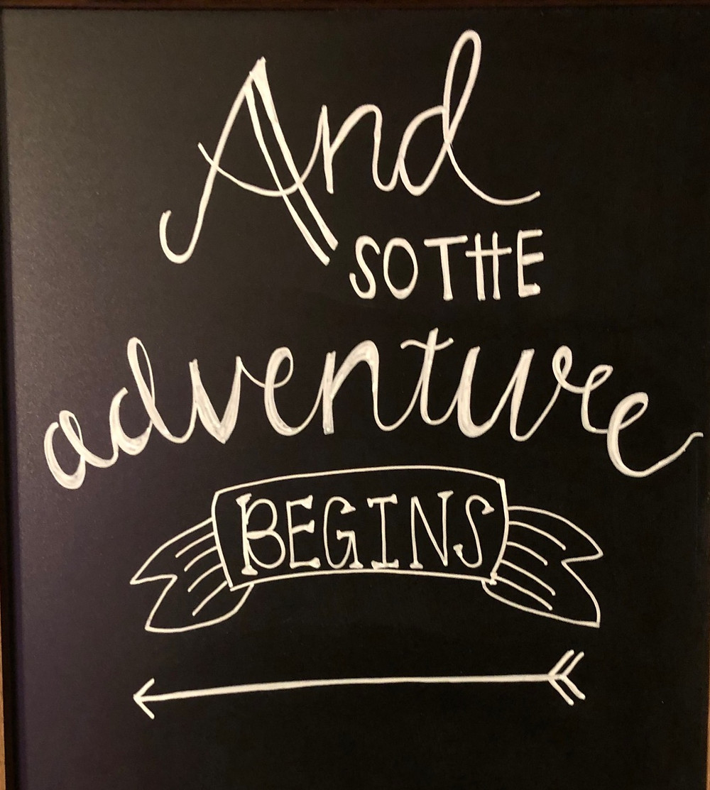 """""""And So the Adventure Begins"""" sign"""