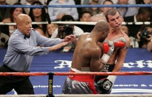 Referee Cortez reacts as Hopkins of the U.S. hits Calzaghe of Wales during their light-heavyweight boxing fight in Las Vegas