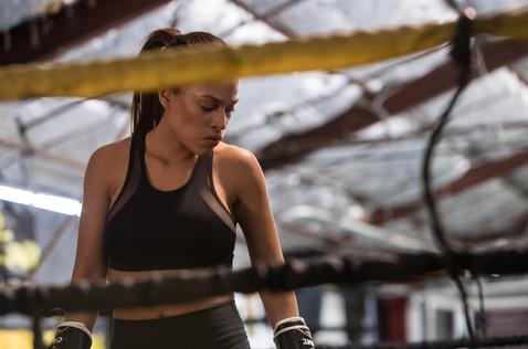 "Roxana Sanchez (Aisha) looks down on her fallen opponent in ""Rag Doll"""
