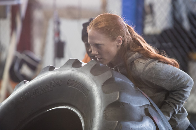 """Shannon Murray (Nora) trains with tires during filming of """"Rag Doll"""""""