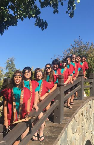 fresno gumyo taiko members standing on a bridge at shinzen gardens, fresno, ca for a photo