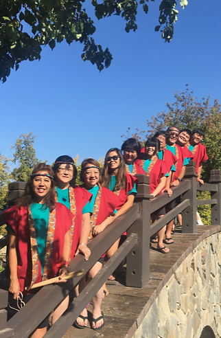 fresno gumyo taiko members standing on a bridge at shinzen gardens, fresno, ca for a photo