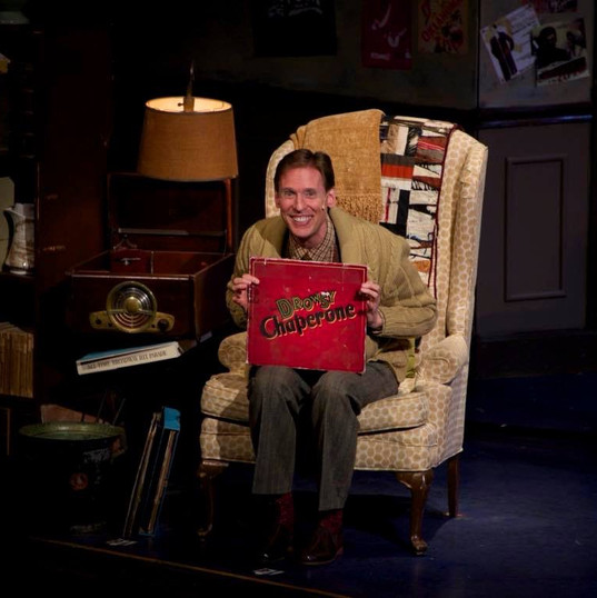 Bruce Linser as Man in Chair